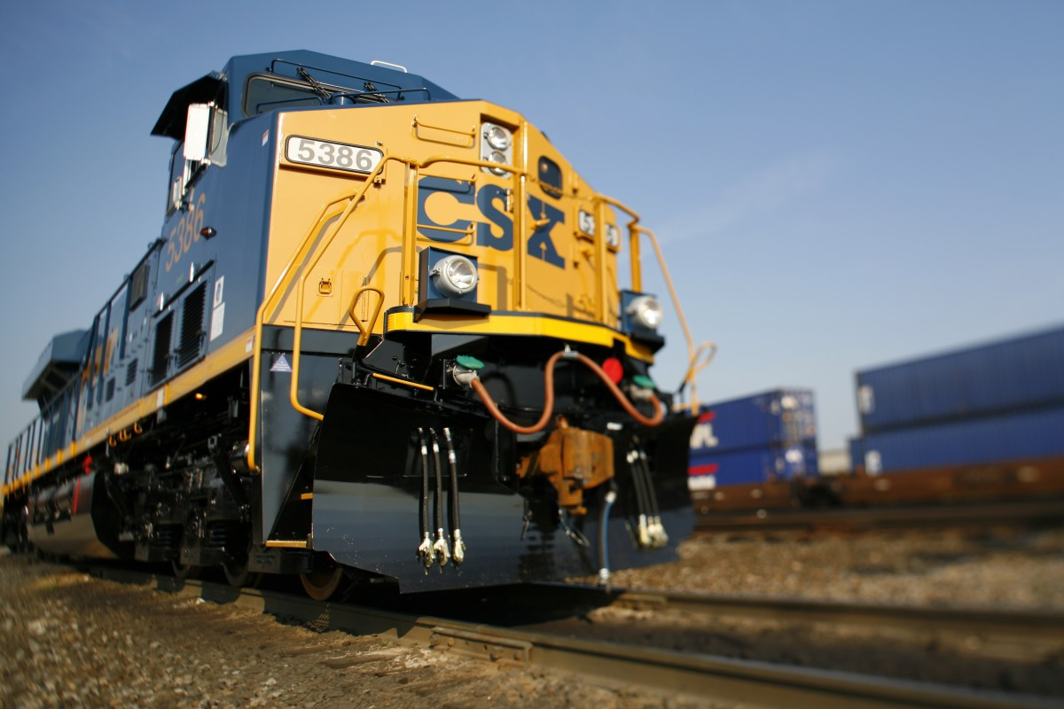 stacked cargo containers with CSX Intermodal logo